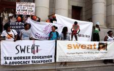 FILE: Sex workers and members of SWEAT demonstrate against alleged harassment by police outside the Cape Town High Court. Picture:Sapa.