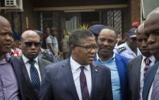 Minister of Police Fikile Mbalula prepares for an escorted trip to the alleged drug house in Vanderbijl Park where Nigerian Nationals assaulted SAPS members. Picture: Thomas Holder/EWN