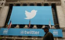 A banner with the logo of Twitter is set on the front of the New York Stock Exchange in New York. Picture: AFP
