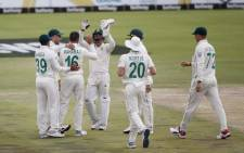 FILE: South Africa's Keshav Maharaj (3rdL) celebrates with teammates after the dismissal of England's Dom Sibley during the third day of the first Test cricket match between South Africa and England at The SuperSport Park stadium at Centurion near Pretoria on 28 December 2019. Picture: AFP