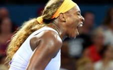 Serena Williams of the US reacts on the way to defeating Victoria Azarenka of Belarus in the women's final at the Brisbane International tennis tournament on January 4, 2014. Picture: AFP.
