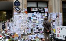 FILE: People visit a makeshift memorial near the headquarters of the French satirical weekly Charlie Hebdo on 12 January 2015 in Paris. Picture: AFP.