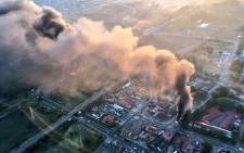 Aerial views of a burning Atteridgeville from the EWN chopper on Tuesday morning.  PictureL Aki Anastasiou/EWN