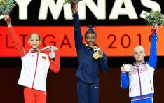 Simone Biles is the most-decorated gymnast of all time after winning gold on Balance Beam. Picture: Twitter/FIG