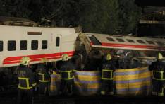 Firefighters and emergency personnel carry on rescue operations after the Puyuma Express train derailed at high speed between Dongshan and Suxin causing at least 18 dead and injuring over 150, in Taiwan's Yilan county on 21 October 2018. Picture: AFP
