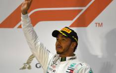 Mercedes' British driver Lewis Hamilton (C) celebrates on the podium after winning the Formula One Bahrain Grand Prix. Picture: AFP.