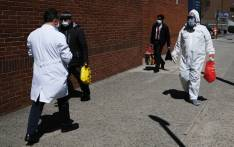 A man wearing a hazmat suit walks outside of Montefiore Medical Center on 6 April 2020 in the Bronx borough of New York City. Hospitals in New York City, which has been especially hard hit by the coronavirus, are facing shortages of beds, ventilators and protective equipment for medical staff. Picture: AFP.