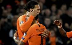 Netherlands' midfielder Virgil van Dijk (L) celebrates with Netherlands' forward Memphis Depay after scoring their fourth goal during the Euro 2020 qualification football match between the Netherlands and Belarus at the Feijenoord stadium in Rotterdam, on 21 March 2019. Picture: AFP