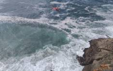 A rescue helicopter conducts a recovery mission after a man was killed when his car plunged over the cliffs at Herolds Bay, near George on 29 January 2020. Picture: @ER24EMS/Twitter