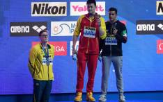 Silver medallist Australia's Mack Horton (L) refuses to stand on the podium with gold medallist China's Sun Yang (C) and bronze medallist Italy's Gabriele Detti after the final of the men's 400m freestyle event during the swimming competition at the 2019 World Championships at Nambu University Municipal Aquatics Center in Gwangju, South Korea, on 21 July 2019. Picture: AFP