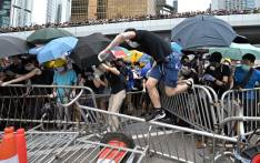 Protesters occupy the roads near the Legislative Council and government headquarters in Hong Kong on 12 June 2019. Tens of thousands of protesters paralysed central Hong Kong, blocking major roads in a defiant show of strength against government plans to allow extraditions to China. Picture: AFP