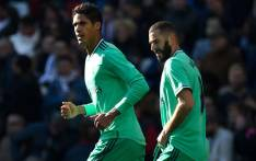 Real Madrid's French defender Raphael Varane (L) celebrates next to Real Madrid's French forward Karim Benzema after scoring a goal during the Spanish League football match between Real Real Madrid CF and RCD Espanyol at the Santiago Bernabeu stadium in Madrid on 7 December 2019. Picture: AFP.