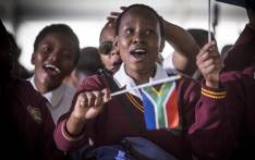FILE: A young school girl waves a little South African flag on 16 June (Youth Day). Picture: EWN