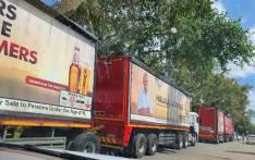 Authorities stop SAB trucks in Kagiso on 8 April 2020. Picture: @FaithMazibukoSA/Twitter