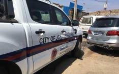 City of Johannesburg officials at a home in Alexandra where four children died after they were left unattended by their mothers. Picture: Katleho Sekhotho/EWN.