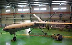 """FILE: A picture released by the official website of Iran's Revolutionary Guards shows a newly Iranian-made drone, """"Shahed 129"""" (Witness 129) being shown in Tehran. Picture: AFP"""