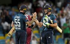 FILE: Ben Stokes (L) and Jos Buttler (R) of England celebrate winning the 1st ODI between West Indies and England at Kensington Oval, Bridgetown, Barbados, on 20 February 2019. Picture: AFP