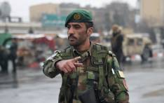FILE: An Afghan security personnel gestures as he guards the site of an attack in Kabul. Picture: AFP