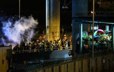FILE: Police fire tear gas to disperse protesters during a demonstration in the district of Yuen Long in Hong Kong on 27 July 2019. Picture: AFP