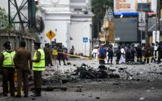 Sri Lankan security personnel inspect the debris of a car after it explodes when police tried to defuse a bomb near St Anthony's Shrine in Colombo on 22 April 2019, a day after the series of bomb blasts targeting churches and luxury hotels in Sri Lanka. Picture: AFP