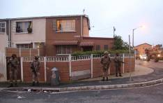 SANDF soldiers on patrol in Hanover Park. The military has released their soldiers to help stabilise gang hotspots, while law enforcement agencies conducted raids in the area. Picture: Bertram Malgas/EWN