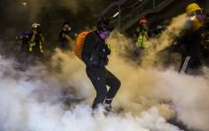 Protesters are enveloped by tear gas along a road in the district of Causeway Bay in Hong Kong on 4 August 2019. Riot police fired tear gas at protesters on Hong Kong's main island, the second consecutive night of unrest in a territory battered by weeks of anti-government rallies. Picture: AFP