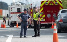 Police block off roads after an unidentified assailant opened fire at a warehouse complex September 20, 2018 in Aberdeen, Maryland, killing and wounding multiple people, authorities said. Picture: AFP.