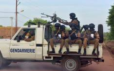 FILE: A picture take on 30 October 2018 shows Burkinabe gendarmes sitting on their vehicle in the city of Ouhigouya in the north of the country. Picture: AFP