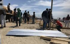 The City of Cape Town is distributing building materials to affected families to the rebuilding of structures. But some residents say it's still not enough & they'll have to buy additional materials. Picture: Monique Mortlock/EWN