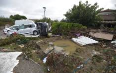 A picture taken in Villemoustaussou, near Carcassone, southern France on 15 October 2018 shows cars swept away following heavy rains that saw rivers bursting banks. Picture: AFP
