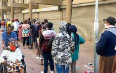 People queuing at pay out points in Mitchells Plain Town Centre on 30 March 2020 to collect their social grants. Picture: Kaylynn Palm/EWN.