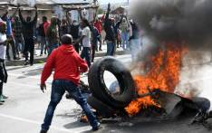 Alexandra township residents burn tyres in the middle of the street as they clash with the Johannesburg Metro Police on 3 April 2019 in Johannesburg, South Africa. Picture: AFP