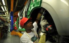 FILE: A worker on a car assembly line. Picture: AFP