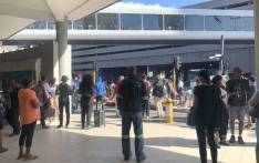 Metrorail commuters are standing outside the Cape Town train station on 27 February 2020 after being told services were suspended due electricity non-payment to Eskom. Picture: Kaylynn Palm/EWN.