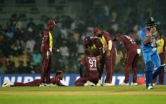 Indian cricketer Manish Pandey (R) walks past as West Indies cricketers reacts after losing the third T20 cricket match between India at the MA Chidambaram Cricket Stadium in Chennai on 11 November 2018. Picture: AFP
