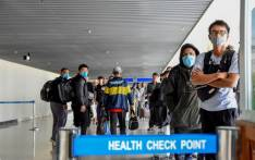 Passengers arriving from China wait in line to be checked by health officials at the Julius Nyerere International Airport in Dar Es Salaam on 29 January 2020. Picture: AFP