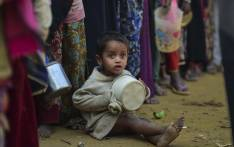 FILE: A Rohingya Muslim refugee waits with others for food aid at Thankhali refugee camp in Bangladesh's Ukhia district on 12 January 2018. Picture AFP