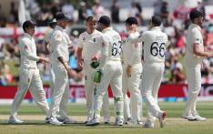 England's Sam Curran (C) celebrates with teammates after taking the wicket of New Zealand's Tom Latham (not pictured) during the second day of the first cricket Test between England and New Zealand at Bay Oval in Mount Maunganui on 22 November 2019. Picture: AFP