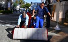 Public Works officials rolling the red carpet outside the Parliamentary precinct ahead of President Cyril Ramaphosa's third State of the Nation Address on 20 June 2019.  Picture: @GCISMedia/Twitter.