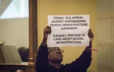 A protester hold a placard in silent protest during President Cyril Ramaphosa's speech at the launch of the Sanitation Appropriate for Education or SAFE Initiative at the Sheraton Hotel in Pretoria on 14 August 2018. Picture: EWN