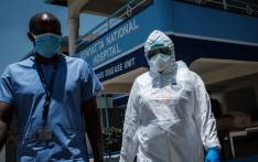 A laboratory specialist wearing protective gear walks toward the ward for quarantined people who had close contacts with the first Kenyan patient of the COVID-19 at the Infectious Disease Unit of Kenyatta National Hospital in Nairobi, Kenya, on 15 March 2020, during the COVID-19 outbreak, caused by the novel coronavirus. Picture: AFP