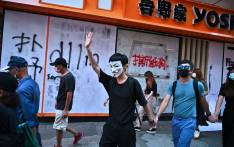 Graffiti is seen at the entrance of a fast-food restaurant as people take part in a flash mob rally in the Mongkok district in Hong Kong on 5 October 2019, a day after the city's leader outlawed face coverings at protests invoking colonial-era emergency powers not used for half a century. Picture: AFP