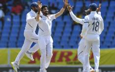 Hanuma Vihari (L) and Jasprit Bumrah (2L) of India celebrate the dismissal of Kraigg Brathwaite of West Indies during day 4 of the 1st Test between West Indies and India at Vivian Richards Cricket Stadium in North Sound, Antigua and Barbuda, on 25 August 2019. Picture: AFP