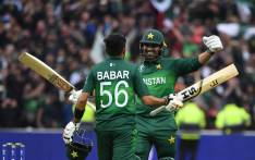 Pakistan's Babar Azam (L) celebrates with teammate Haris Sohail after scoring a century (100 runs) during the 2019 Cricket World Cup group stage match between New Zealand and Pakistan at Edgbaston in Birmingham, central England, on 26 June 2019. Picture: AFP