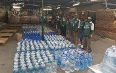 FILE: Gift of the Givers workers prepare to handover bottled water to municipalities facing drought. Picture: www.giftofthegivers.org.