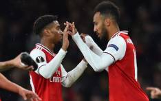 FILE: Arsenal's Gabonese striker Pierre-Emerick Aubameyang (R) comes on for Arsenal's English midfielder Reiss Nelson (L) during the UEFA Europa League Group F football match between Arsenal and Standard Liege at the Arsenal Stadium in London on 3 October 2019. Picture: AFP.