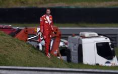 Ferrari driver Sebastian Vettel leaves the racetrack while a crane lifts his car during the F1 Brazil Grand Prix, at the Interlagos racetrack in Sao Paulo, Brazil on 17 November 2019. Picture: AFP