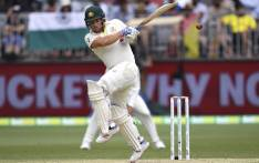 Australia's Aaron Finch gloves a ball down leg from the Indian bowling on the third day of the second cricket Test match in Perth on 16 December 2018.  Picture: AFP