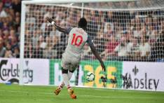 Liverpool's Senegalese striker Sadio Mane puts the ball into the open net after beating Crystal Palace's Welsh goalkeeper Wayne Hennessey to score their second goal during the English Premier League football match between Crystal Palace and Liverpool at Selhurst Park in south London on 20 August, 2018. Picture: AFP.