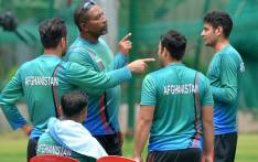 FILE: Afghanistan cricket team coach Phil Simmons (2L) speaks with cricketers during a practice session at the M. Chinnaswamy Stadium in Bangalore on 12 June 2018. Picture: AFP